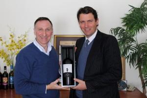 Julius Angelini and Salvatore Ferragamo shown holding a limited edition Petite Syrah